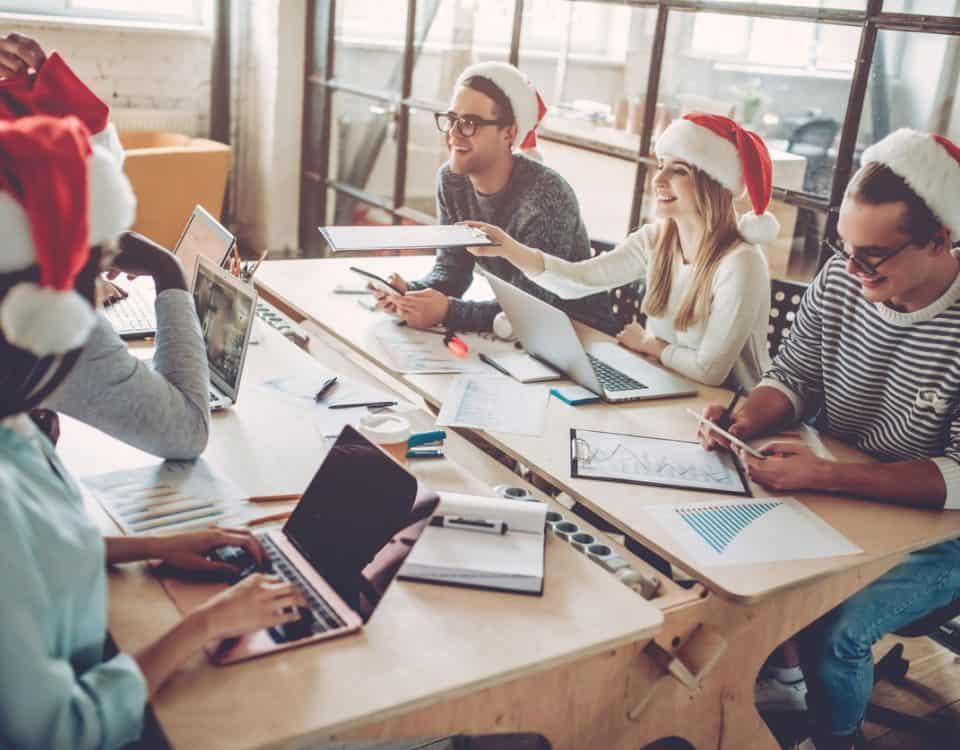 office staff in Santa hats