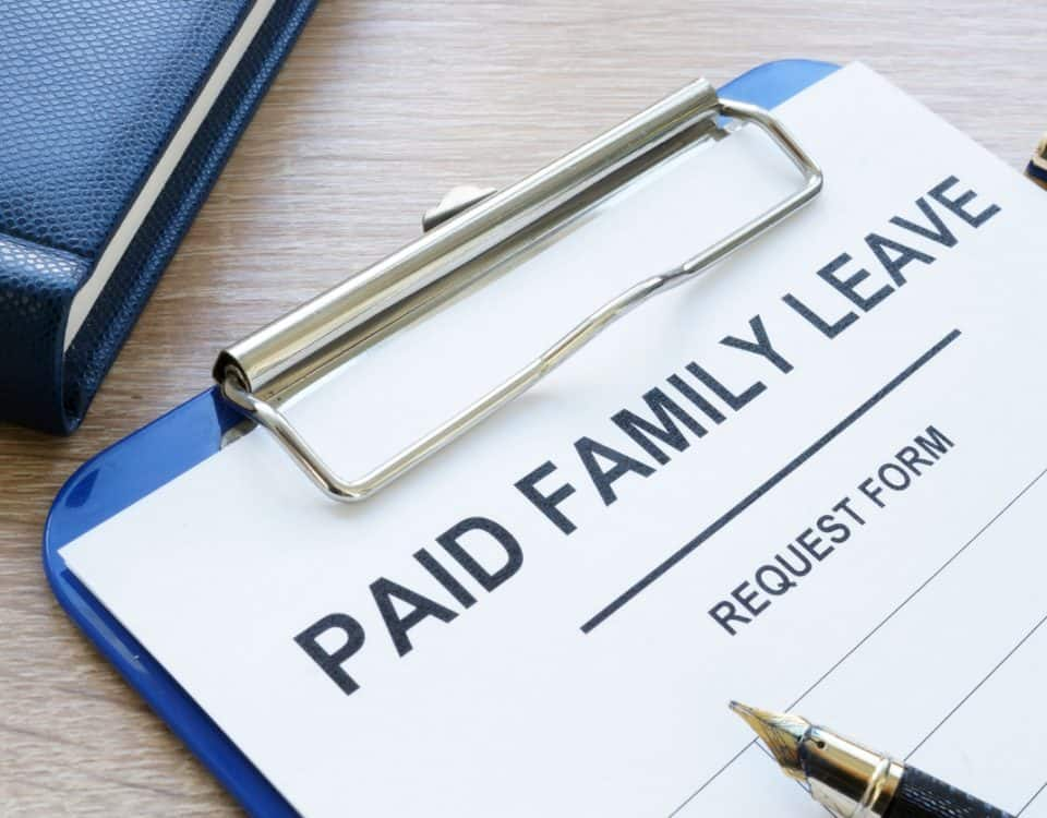 Paid family leave form in clipboard and note pad