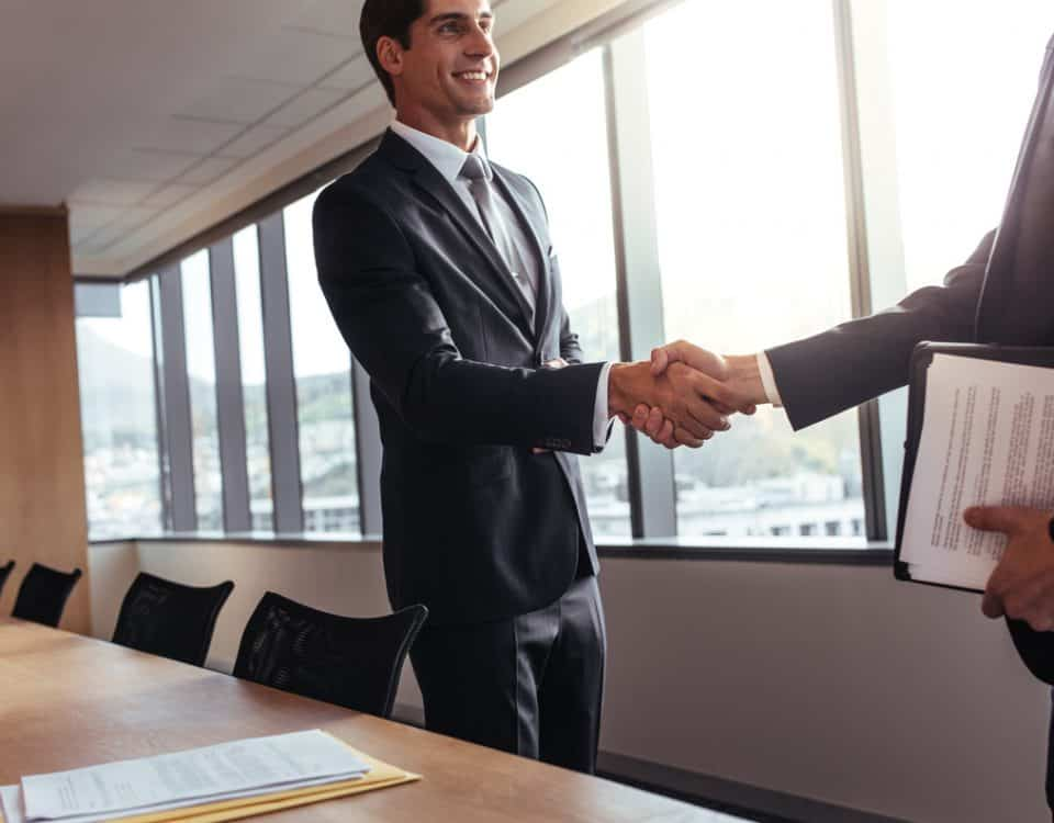 Business man shaking hands after a successful meeting