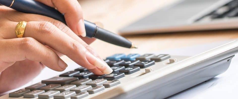 Coronavirus Thumbnail - woman typing on calculator